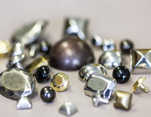 Pieces of metal smallware for the leather industry
